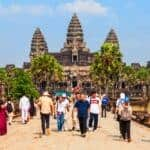 Tourists at Angkor Wat. Stock Photos by saiko3p / Shutterstock