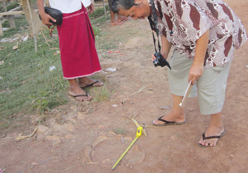 A researcher looks at a potential Martaban Jar in Mon State, Myanmar Times 20121126
