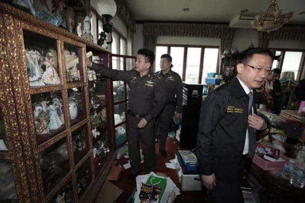 Officials raiding the former police CIB chief's house. Source: Bangkok Post 20150424