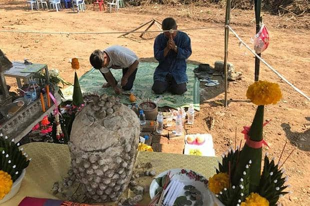 Ancient pottery, Buddha head found buried in Chiang Rai