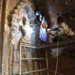 Frescoes being repaired in Bagan