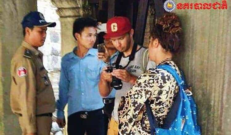 Russian pair held for offensive photos at Angkor Wat