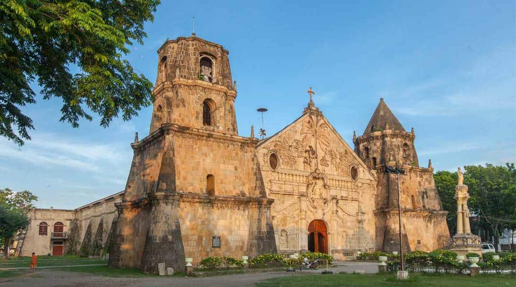 Miagao Church's naked coralline limestone, a mistake for authenticity