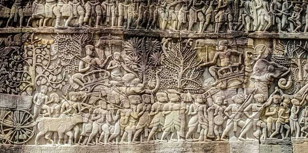 Bas relief sculpture, elephant charging into battle and the battle between the Cham and Khmer. The battles conducted by Jayavarman VII against the invading Cham. Bayon Temple, Angkor Thom, Seam Reap. Source: Jak149 / Shutterstock