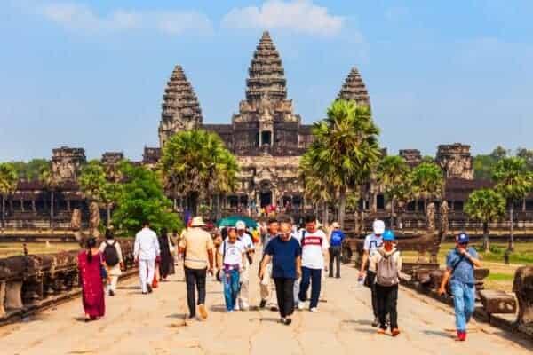 Tourists at Angkor Wat. Stock Photos by saiko3p / Shutterstock