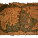 Old Chinese world map on vintage burned paper background. Stock photo from Shutterstock / BaanTaksinStudio