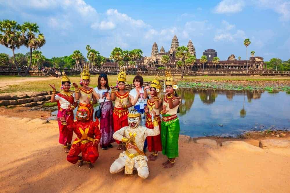 Artists in Khmer costume posing in front of Angkor Wat. Stock photo from Shutterstock / saiko3p