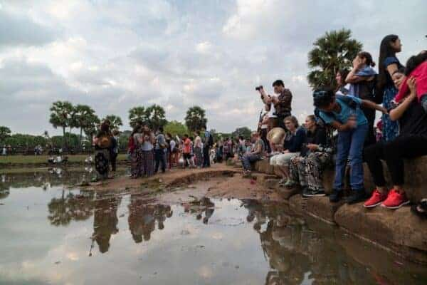 Tourists at Angkor Wat. Stock photos from Shutterstock / daphnusia