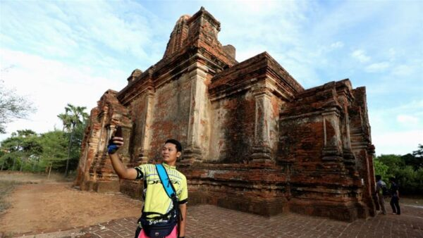 Cyclist taking selfie in Bagan. Source: Al Jazeera, 20190804