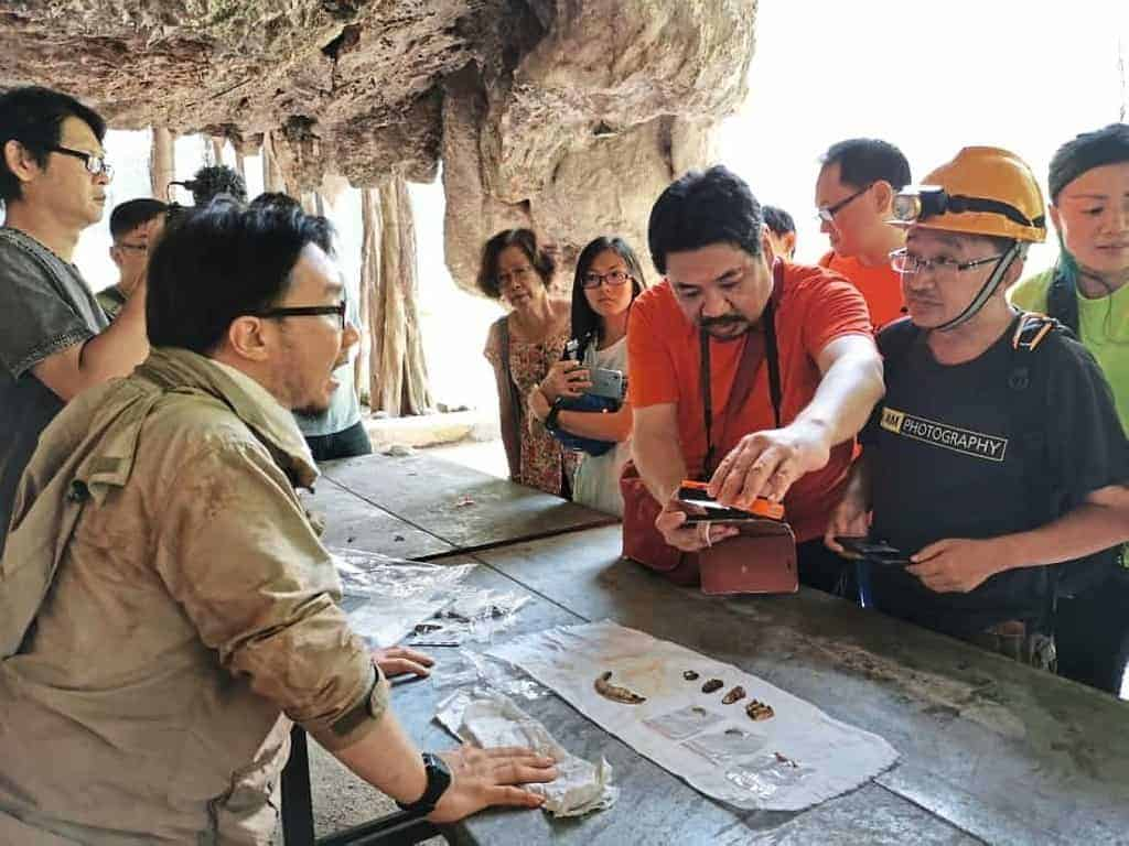 Participants having a closer look at some bone fossils found by caving enthusiasts in Gunung Rapat, Ipoh. Source: The Star, 20190809
